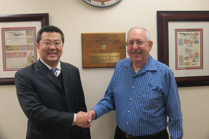 IALI Professors Weiman Diao (left) and Stephen Rudolph of DePaul Law