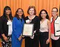 The Asylum and Immigration Law Clinic Receives the Legal Education Award from the ISBA